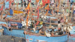 Fishermen busy in boats in harbour,Porbandar,India Stock Footage