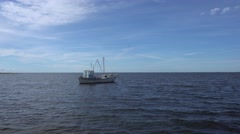Lone Fishing Boat Calm Water Stock Footage