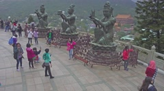 Tian Tan Buddha and buddhist statues in Hong Kong Stock Footage