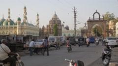 Street with traffic and Mahabat Maqbara mausoleum,Junagadh,India Stock Footage