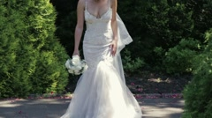 Amazing young bride in her white wedding dress and bridal vail, with wedding Stock Footage