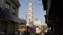 Minaret of mosque and traffic,Junagadh,India Stock Footage