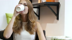 Beautiful Girl Drinking Coffee, Thinking at Work, Sitting Relax Stock Footage