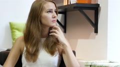Beautiful Girl Thinking at Work, Sitting Relax Stock Footage
