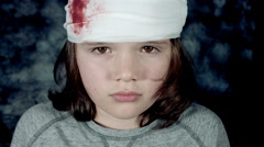 4k Dramatic Shot of a Injured Child Having his Head Bleeding with Bandages Stock Footage