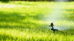 Watering system works on lawn with fresh green grass Stock Footage
