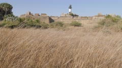 Fort and lighthouse and field,Diu,India Stock Footage