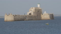 Fortim-do-Mar from fort with rowing boat,Diu,India Stock Footage