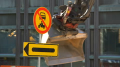 Heavy Equipment working at the construction site. Warning sign. Stock Footage