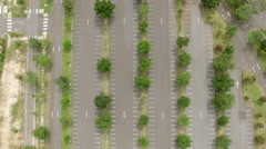 Aerial view ; empty carpark with green grass and tree. Stock Footage