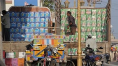 Men unloading boxes beer from truck,Diu,India Stock Footage