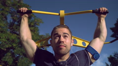 Handsome male with smartphone on the brawny hand at the open air gym Stock Footage