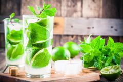 Fresh mojito cocktails with lime, mint and ice in glass Kuvituskuvat