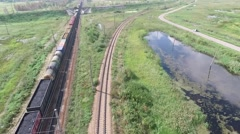 The leaving cargo train, aerial shooting Stock Footage