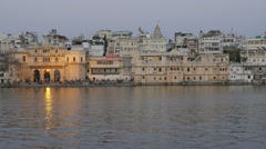Gangaur ghat and hotels at lake in evening,Udaipur,India Stock Footage