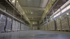 Large furniture warehouse. Mezzanine shelving with large packages of food  Stock Footage