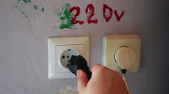 Plugging and sticking a plug into a socket Stock Footage
