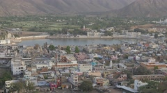 View from above on town with holy lake,Pushkar,India Stock Footage