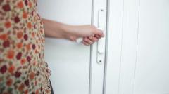Female hand open doors Stock Footage