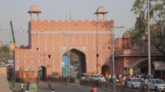 Traffic passing through Chandpole gate,Jaipur,India Stock Footage