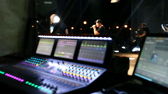 Sound engineer work on the audio mixer at a concert Stock Footage