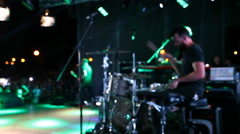 Musicians playing on stage, bright lights, rock concert Stock Footage