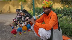 Indian musician playing traditional flute,Jaipur,Gangaur,India Stock Footage