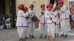Indian folk musicians in procession at Tripolia gate,Jaipur,Gangaur,India Stock Footage
