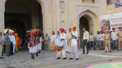 Folk dancers with stick in procession,Jaipur,Gangaur,India Stock Footage