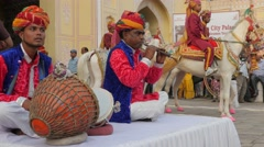 Traditional musicians at Tripolia gate,Jaipur,Gangaur,India Stock Footage