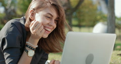 Young , beautiful girl is in correspondence in social networks using laptop Stock Footage
