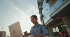 Beautiful girl in business clothes corresponds with the client Stock Footage