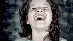 4k Funny Shot of a Child Laughing Out Loud, colour graded Stock Footage