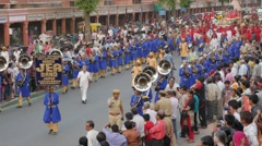 Marching brass band in procession,Jaipur,Gangaur,India Stock Footage