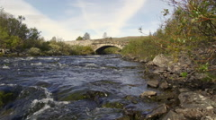 Old preserved bridge dovrefjell norway distant view slider left to right Stock Footage