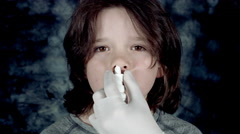 4k Dramatic Shot of a Child and a Doctor Hand Spraying Medicine in his Nose Stock Footage