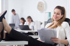 She knows how to survive stress at work Stock Photos