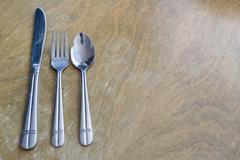 A nice old cutlery set up on a wooden table Stock Photos