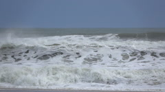 Waves crash on to the shore Stock Footage