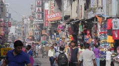 Busy shopping street in Main Bazar,New Delhi,India Stock Footage