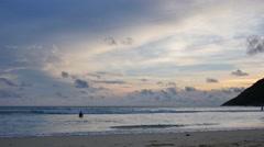 Sunset swim at beautiful paradise island Nai Harn, in Phuket, Thailand Stock Footage