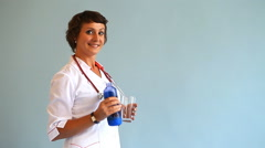 Young woman doctor shows how useful water for human health Stock Footage