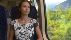 Lonely woman travels by train thinking of farewell Stock Footage