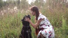 Girl hugging a dog Stock Footage