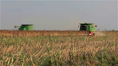 Moderns combines harvesting sunflower seeds in the field in South Ukraine Stock Footage