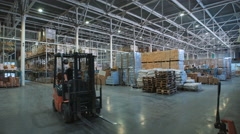 Long stack arrangement of goods in a wholesale and retail warehouse depot Stock Footage