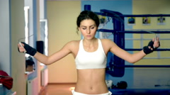 Female Boxer training with Skipping rope in Boxing club. Stock Footage