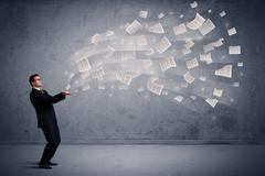 Caucasian businessman holding newspapers Stock Photos