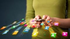 Man holding smartphone with technology application icons Stock Photos
