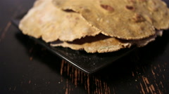Flatbreads on the black plate Stock Footage